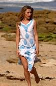 Blue Print Beach Dress - Supermodel Eva Nadenchova - Ocean Waves Rock Background — Stock Photo