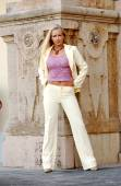 Yellow-Beige Business Suit - Pink Tube Top - Carved Stone Background — Foto de Stock