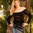 Black Lace Sleeve Top - Shiny Leather Skirt - Tall Brunette — Stock Photo #52418271