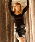 Black Lace Sleeve Top - Shiny Leather Skirt - Tall Brunette — Stock Photo