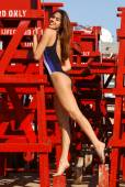 Brazilian Model Plays on a Red Guard Tower - One Piece Two-Tone Blue with White Stripe — ストック写真