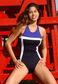 Brazilian Model Plays on a Red Guard Tower - One Piece Two-Tone Blue with White Stripe — Foto de Stock
