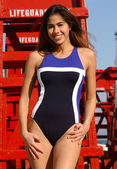 Brazilian Model Plays on a Red Guard Tower - One Piece Two-Tone Blue with White Stripe — Stock Photo