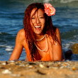 Постер, плакат: Playboy Model Angela Storms Laughing on the Beach