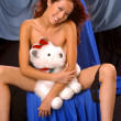 Постер, плакат: Teddy Bear Hugs Playboy Model Angela Storms