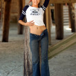 Постер, плакат: Playboy Model Angela Storms Little Angel Shirt Tight Blue Jeans