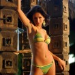 Cute Green and Yellow Striped Bikini - Cool Rock Formation Background — Stock Photo #53618999