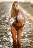 White Sheer Top - Brown Bikini Bottoms - Dark Water Background — Zdjęcie stockowe
