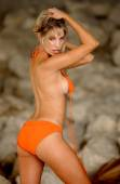 Orange Bikini String Ties Dangling Loose - Stunning Blond - Rock Formation Background — Stock Photo