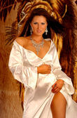 Satin Robe - Silver Jewelry - Sultry Brunette — Stock Photo