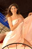 Peach Satin Sheets - Playful Happy Gorgeous Brazilian Hotty - Front View — Stock Photo