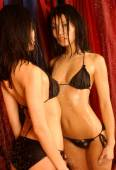 Mirrored Slim Sexy Asian - Skimpy Black Bikini — Stock Photo