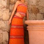 Model in Ethnic Skirt and  Orange Top — Stock Photo #54699317
