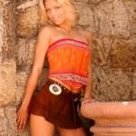 Model in Ethnic Skirt and  Orange Top — Stock Photo #54699393