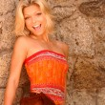 Model in Ethnic Skirt and Orange Top — Stock Photo #54699451