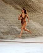 Off the Ground - In Mid Air  - Brazilian Brunette Running — Stock Photo