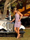 Professional Blonde Model Poses In Front of a Cool Car in a Pretty Dress — Stockfoto