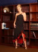 Elegant Black Drees with Red Trim - Library Studio Background — Stock Photo