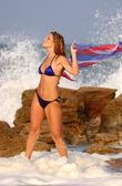 Beautiful model in bikini on the ocean beach — Stock Photo