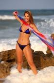 Patriotic Red White and Blue Bikini Shoot - Ocean Waves and Beach Background - Professional Model Ebony P - Plenty of Copy-Space — Stock Photo
