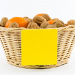 Small Basket with Walnuts, Tangerines and Yellow Note — Stock Photo #54152745