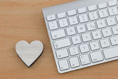 Wooden Heart next to Keyboard — Stock Photo