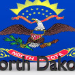 US state North Dakota, metal name in front of flag — Stock Photo #58789575