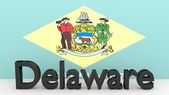 US state Delaware, metal name in front of flag — Foto de Stock