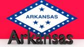 US state Arkansas, metal name in front of flag — Stock Photo