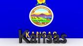 US state Kansas, metal name in front of flag — Foto de Stock