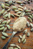 Ground cardamom in a spoon — Stock Photo