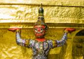 Close-up of a demon guardian supporting Wat Phra Kaew, Bangkok, Thailand — ストック写真