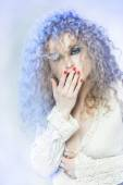 Very beautiful curly girl with red manicure — Stock fotografie