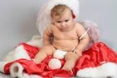 赤ちゃん天使グッズを見て — ストック写真