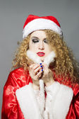 Sad Santa - beautiful curly girl — Stockfoto