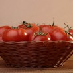 Ripe tomatoes in basket — Stock Photo #68217843