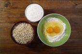 Set of ingredients for baking with yolk in flour  — Stock Photo