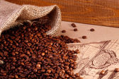 Coffee beans in a burlap bag — Stock Photo