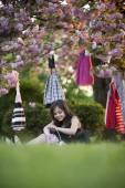 Cute girl sitting in the garden — Foto de Stock
