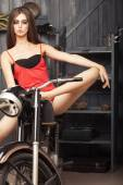 Beautiful sexual young girl om motorbike — Stock Photo