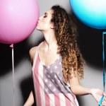Happy young beautiful girl kissing balloons — Stock Photo #73600493