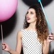 Smiling young beautiful girl with balloons — Stock Photo #73600729
