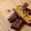 Sweet chocolate bars and peanut brittle — Stock Photo #73802909