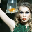 Sexy girl with goldfish — Stock Photo #75510801