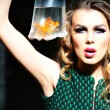Dramatic girl with goldfish — Stock Photo #75729805