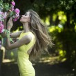 Young lady and pink roses — Stockfoto #76222635