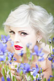 Portrait of woman with iris flowers — Stock Photo