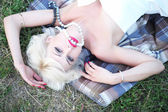 Portrait of lady on grass — Stock Photo