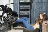 Tempting girl in garage — Стоковое фото