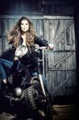 Cool girl in garage — Stock Photo